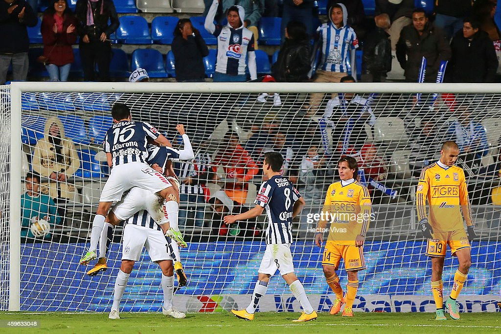 Rodrigo Salinas of Pachuca celebrates with teammates after scoring the first goal of his team during a quarterfinal first leg match between Pachuca...