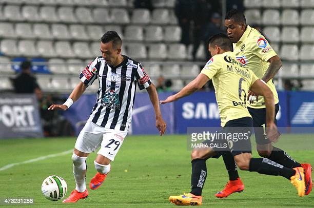Rodrigo Salinas of Pachuca vies for the ball with Miguel Samudio and Michael Arroyo of America during their 2015 Mexican Clausura tournament first...