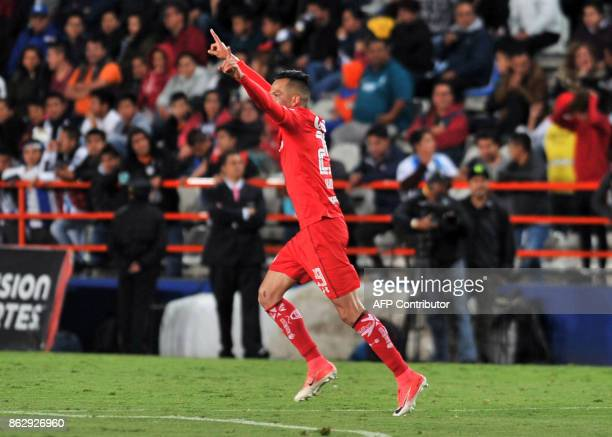 Rodrigo Salinas of Toluca celebrates his goal against Pachuca during their Mexican Apertura tournament football match at the Hidalgo stadium on...