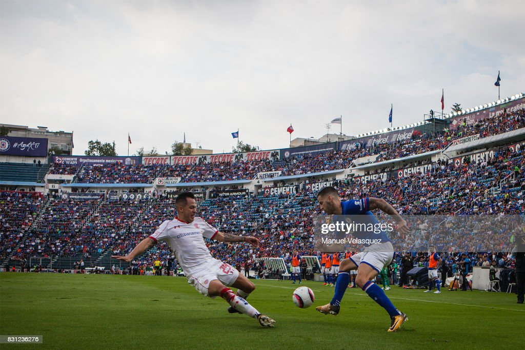 Rodrigo Salinas (L) of Toluca struggle for the ball against Edgar Mendez (R) of Cruz Azul during the 4th round match between Cruz Azul and Chivas as part of the Torneo Apertura 2017 Liga MX at Azul Stadium on August 12, 2017 in Mexico City, Mexico.