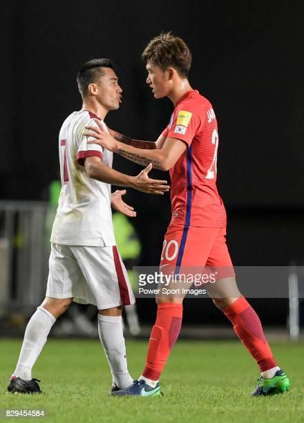 Rodrigo Tabata of Qatar and Jang Hyunsoo of Korea Republic talk during the 2018 FIFA World Cup Russia Asian Qualifiers Final Qualification Round...