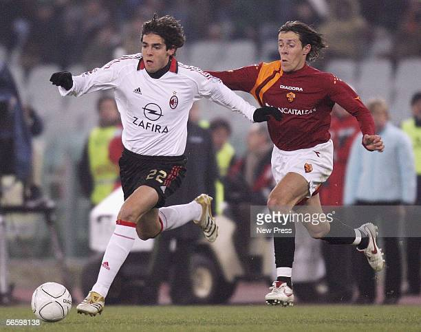 Rodrigo Taddei of Roma competes with Ricardo Kaka of AC Milan during the Serie A match between Roma and AC Milan at the Stadio Olimpico on January 15...