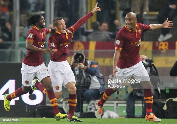 Rodrigo Taddei with his teammate Gervinho and Maicon of AS Roma celebrates after scoring the opening goal during the Serie A match between AS Roma...