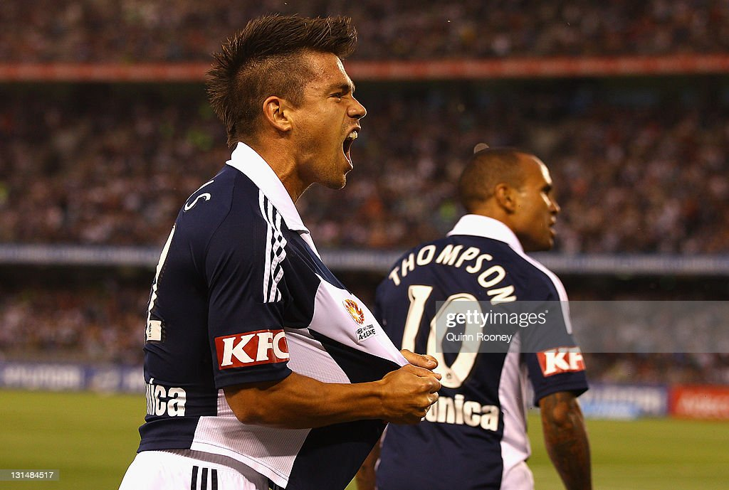 <a gi-track='captionPersonalityLinkClicked' href=/galleries/search?phrase=Rodrigo+Vargas&family=editorial&specificpeople=793290 ng-click='$event.stopPropagation()'>Rodrigo Vargas</a> celebrates a goal by Archie Thompson of the Victory during the round five A-League match between the Melbourne Victory and the Brisbane Roar at Etihad Stadium on November 5, 2011 in Melbourne, Australia.
