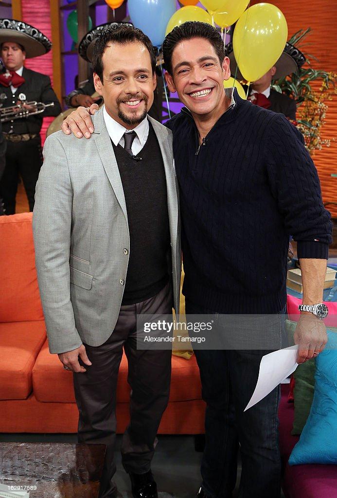 Rodrigo Vidal and Johnny Lozada celebrate Univision's Tlnovelas cable network first anniversary on Despierta America at Univision Headquarters on March 1, 2013 in Miami, Florida.