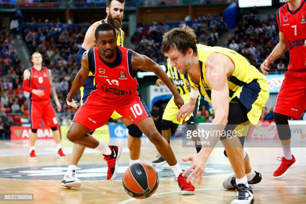 Rodrigue Beaubois #10 of Baskonia Vitoria Gasteiz competes with Jan Vesely #24 of Fenerbahce Dogus Istanbul during the 2017/2018 Turkish Airlines...
