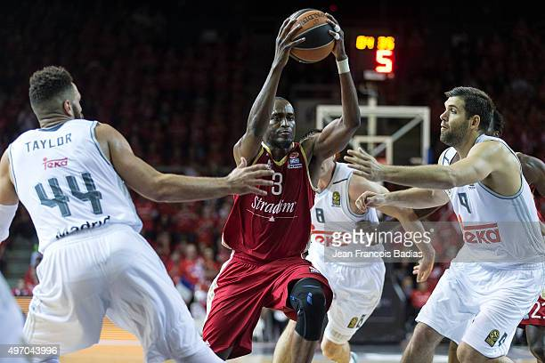 Rodrigue Beaubois #3 of Strasbourg competes with Jeffery Taylor #44 of Real Madrid and Felipe Reyes #9 of Real Madridduring Regular Season date 5...