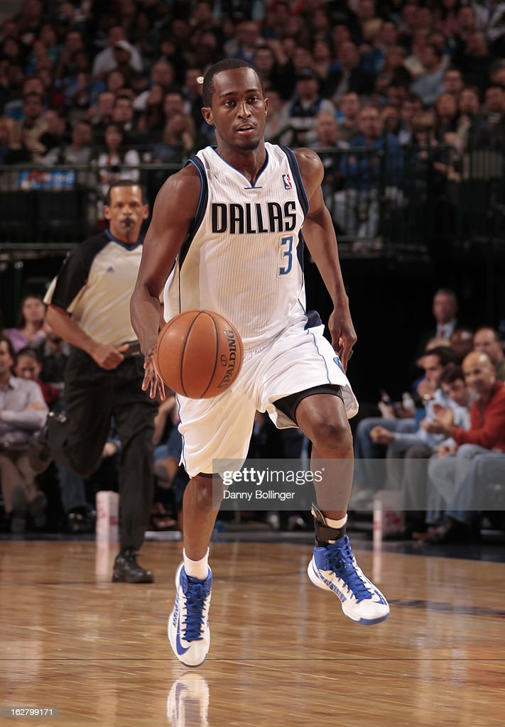 <a gi-track='captionPersonalityLinkClicked' href=/galleries/search?phrase=Rodrigue+Beaubois&family=editorial&specificpeople=5299423 ng-click='$event.stopPropagation()'>Rodrigue Beaubois</a> #3 of the Dallas Mavericks brings the ball up court against the Washington Wizards on November 14, 2012 at the American Airlines Center in Dallas, Texas.