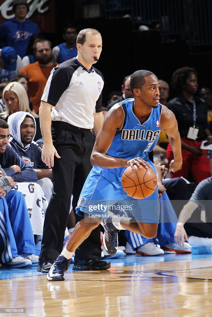 <a gi-track='captionPersonalityLinkClicked' href=/galleries/search?phrase=Rodrigue+Beaubois&family=editorial&specificpeople=5299423 ng-click='$event.stopPropagation()'>Rodrigue Beaubois</a> #3 of the Dallas Mavericks drives against the Oklahoma City Thunder on February 04, 2013 at the Chesapeake Energy Arena in Oklahoma City, Oklahoma.