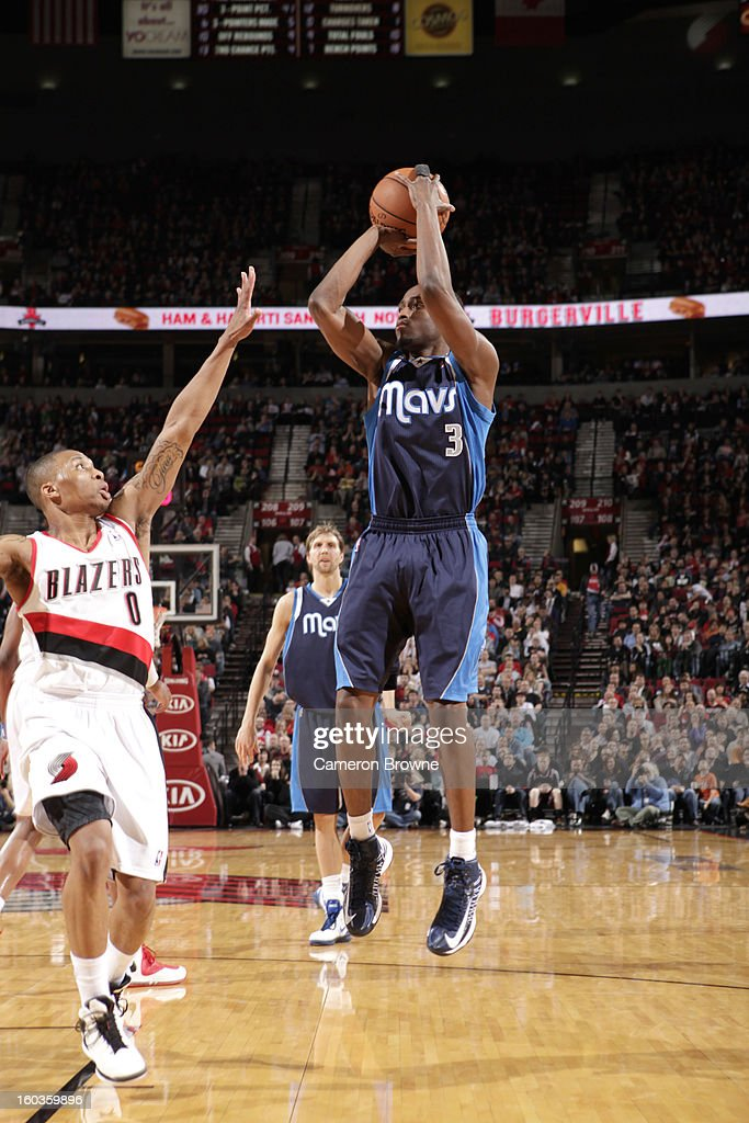 Rodrigue Beaubois #3 of the Dallas Mavericks goes for a jump shot against Damian Lillard #0 of the Portland Trail Blazers during the game between the Dallas Mavericks and the Portland Trail Blazers on January 29, 2013 at the Rose Garden Arena in Portland, Oregon.
