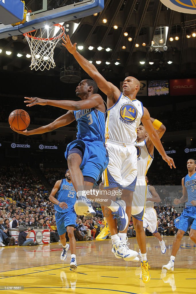 <a gi-track='captionPersonalityLinkClicked' href=/galleries/search?phrase=Rodrigue+Beaubois&family=editorial&specificpeople=5299423 ng-click='$event.stopPropagation()'>Rodrigue Beaubois</a> #3 of the Dallas Mavericks lays the ball up against <a gi-track='captionPersonalityLinkClicked' href=/galleries/search?phrase=Richard+Jefferson&family=editorial&specificpeople=201688 ng-click='$event.stopPropagation()'>Richard Jefferson</a> #44 of the Golden State Warriors on April 12, 2012 at Oracle Arena in Oakland, California.