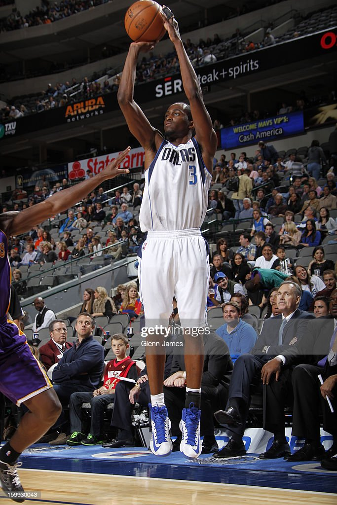 <a gi-track='captionPersonalityLinkClicked' href=/galleries/search?phrase=Rodrigue+Beaubois&family=editorial&specificpeople=5299423 ng-click='$event.stopPropagation()'>Rodrigue Beaubois</a> #3 of the Dallas Mavericks takes a shot against the Los Angeles Lakers on November 24, 2012 at the American Airlines Center in Dallas, Texas.