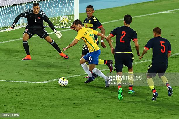 Rodriguinho of Brazil kicks the ball during a match between Brazil and Colombia as part of Friendly Match In Memory of Associacao Chapecoense de...