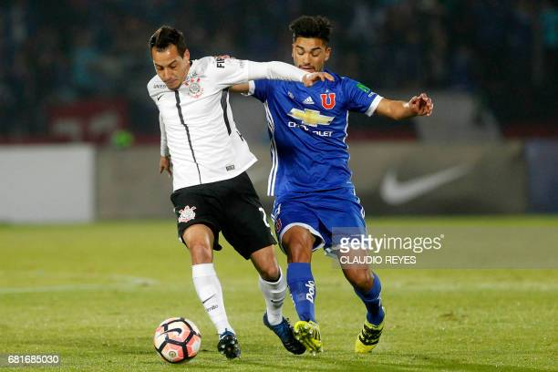 Rodriguinho of Brazil's Corinthians vies for the ball with Lorenzo Reyes of Chile's Universidad de Chile during their 2017 Sudamericana Cup football...