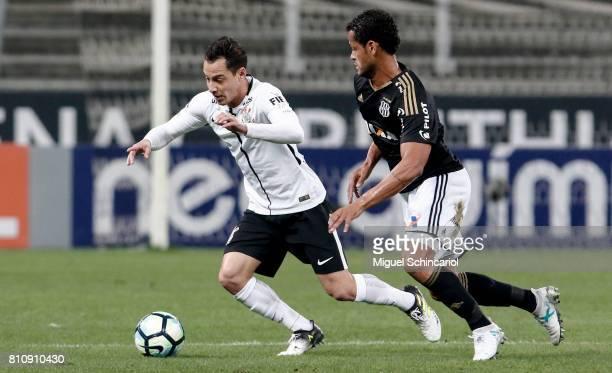 Rodriguinho of Corinthians vies for the ball with Elton of Ponte Preta during the match between Corinthians and Ponte Preta for the Brasileirao...