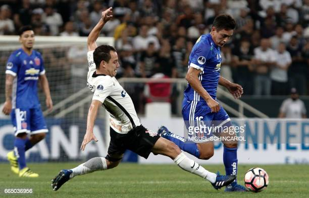 Rodriguinho of Corinthians vies for the ball with M Rodriguez of Universidad de Chile during their 2017 Sudamericana Cup football match held at the...