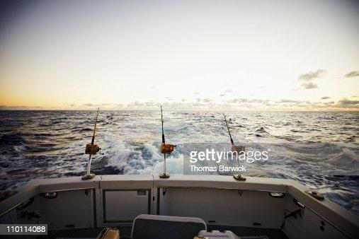 Rods and reels on board of sport fishing boat : Foto de stock