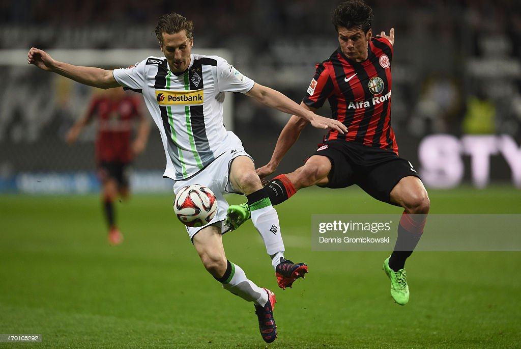 <a gi-track='captionPersonalityLinkClicked' href=/galleries/search?phrase=Roel+Brouwers&family=editorial&specificpeople=711197 ng-click='$event.stopPropagation()'>Roel Brouwers</a> of Borussia Moenchengladbach is challenged by <a gi-track='captionPersonalityLinkClicked' href=/galleries/search?phrase=Nelson+Haedo+Valdez&family=editorial&specificpeople=556805 ng-click='$event.stopPropagation()'>Nelson Haedo Valdez</a> of Eintracht Frankfurt during the Bundesliga match between Eintracht Frankfurt and Borussia Moenchengladbach at Commerzbank-Arena on April 17, 2015 in Frankfurt am Main, Germany.