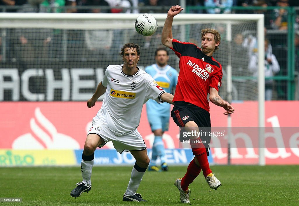 Roel Brouwers of Gladbach and Stefan Kiessling of Leverkusen battle for the ball during the Bundesliga match between Borussia Moenchengladbach and...