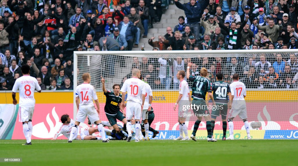 Roel Brouwers of Gladbach celebrates scoring his team's first goal during the Bundesliga match between Borussia Moenchengladbach and Hamburger SV at...