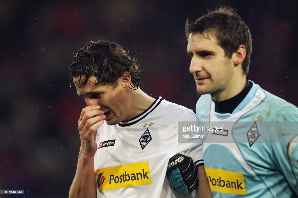 Roel Brouwers of M'Gladbach reacts as he is led off the pitch by goalkeeper Christofer Heimeroth during the Bundesliga match between SC Freiburg and...