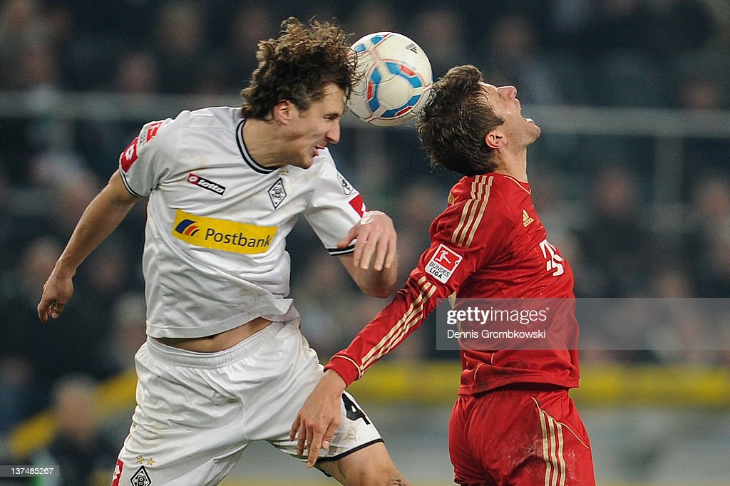 Roel Brouwers of Moenchengladbach and Thomas Mueller of Bayern jump for a header during the Bundesliga match between Borussia Moenchengladbach and FC...
