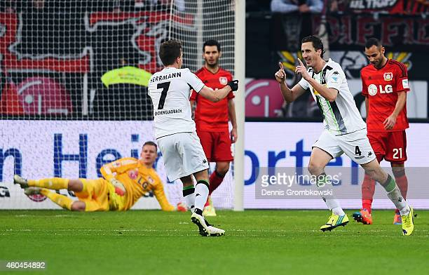 Roel Brouwers of Moenchengladbach celebrates his team's first goal with team mate Patrick Herrmann during the Bundesliga match between Bayer 04...