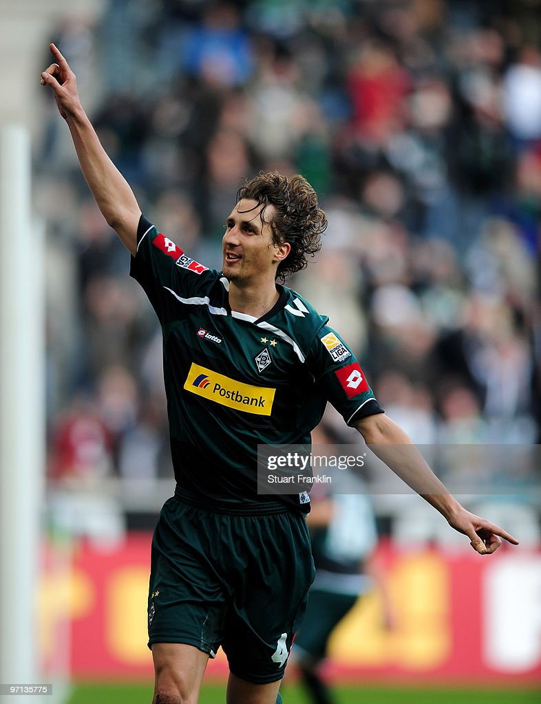 Roel Brouwers of Moenchengladbach celebrates scoring his goal during the Bundesliga match between Borussia Moenchengladbach and SC Freiburg at...