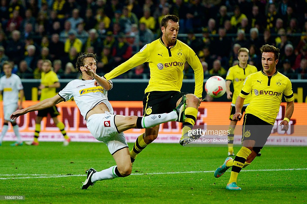 Roel Brouwers of Moenchengladbach clears the ball under the pressure of Julian Schieber of Dortmund during the Bundesliga match between Borussia...