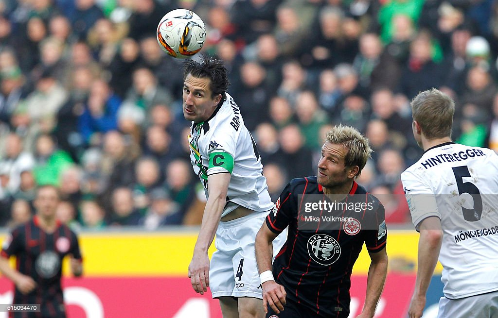 Roel Brouwers of Moenchengladbach jumps for a header against Stefan Aigner of Frankfurt during the Bundesliga match between Borussia Moenchengladbach...