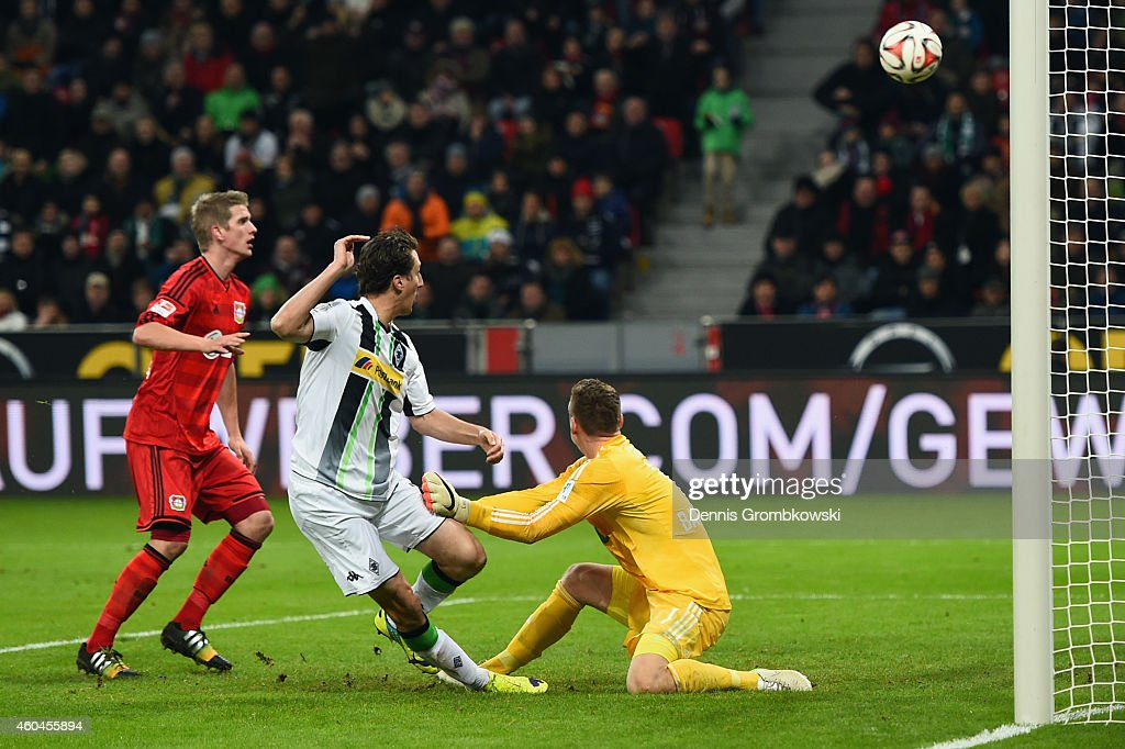 Roel Brouwers of Moenchengladbach misses a chance to score against goalkeeper Bernd Leno and Lars Bender of Leverkusen during the Bundesliga match...
