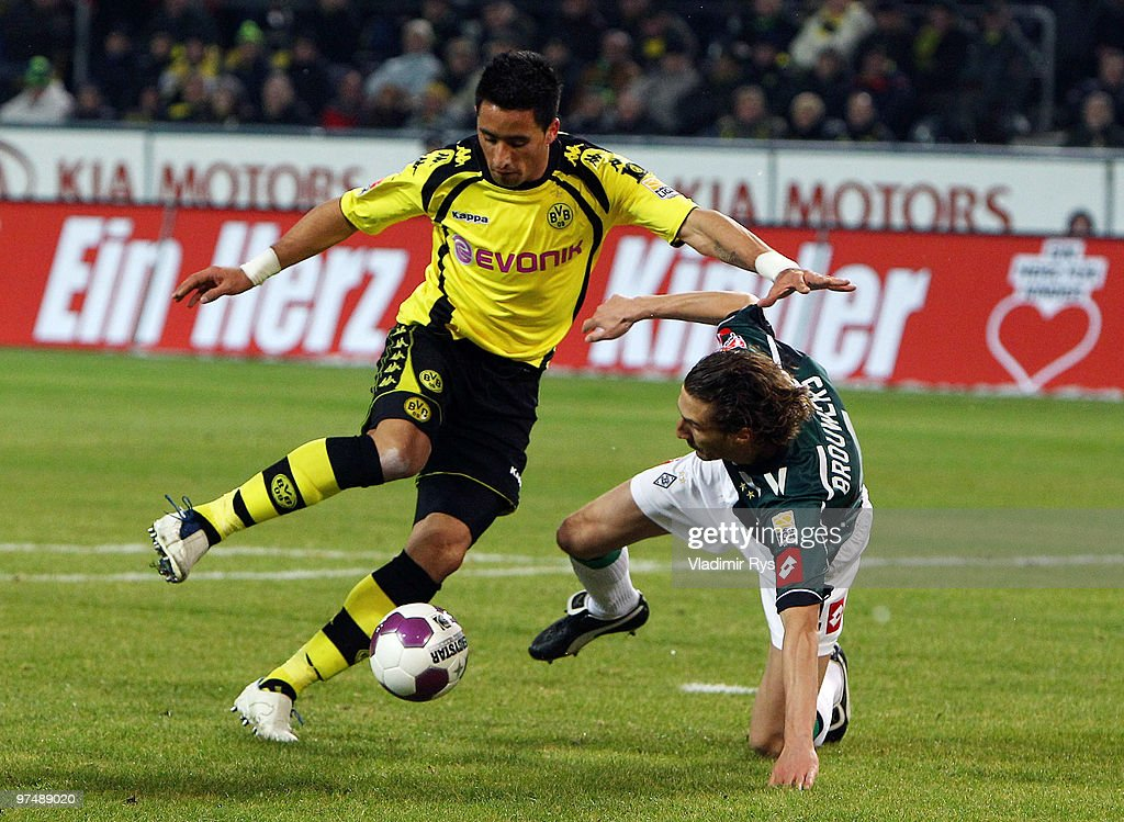 Roel Brouwers of Moenchengladbach tries to stop Lucas Barrios of Dortmund during the Bundesliga match between Borussia Dortmund and Borussia...