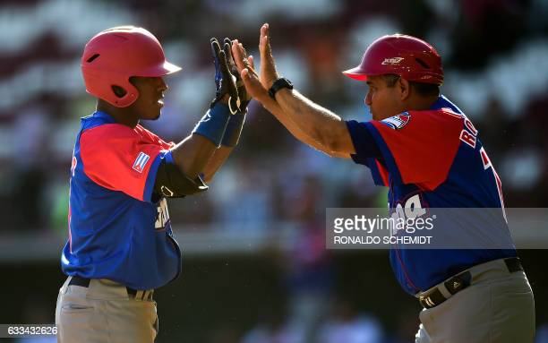 Roel Santos of Alazanes de Granma of Cuba celebrates after scoring against Tigres de Licey of the Dominican Republic during the Caribbean Baseball...