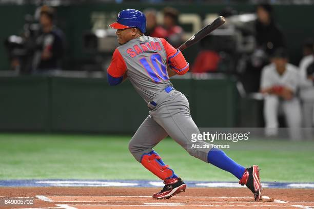 Roel Santos of Cuba hits a single in the XXth inning of the World Baseball Classic Pool B Game One between Cuba and Japan at Tokyo Dome on March 7...
