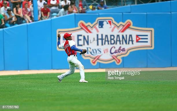 Roel Santos throws back to the infield during the game against the Tampa Bay Rays at Estadio Latinoamericano on Tuesday March 22 2016 in Havana Cuba