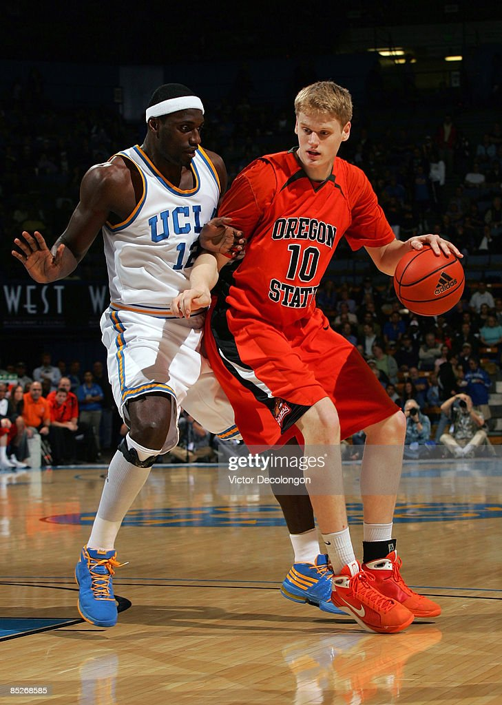 Roeland Schaftenaar of the Oregon State Beavers dribbles the ball against Alfred Aboya of the UCLA Bruins in the first half during their NCAA...