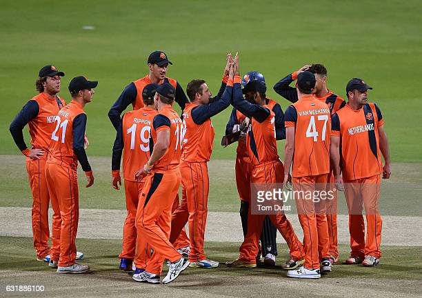 Roelof van der Merwe of Netherlands celebrates taking the wicket of George Munsey of Scotland during the Desert T20 Challenge match between...