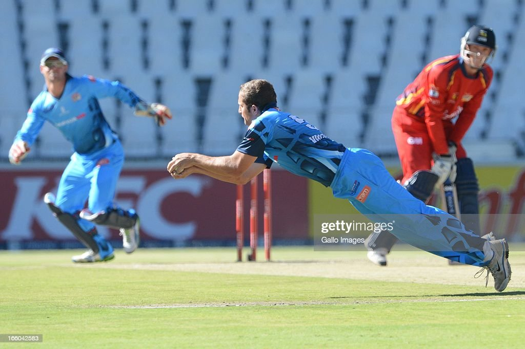 Roelof van der Merwe of the Nashua Titans takes the wicket of Rassie van der Dussen during the 2013 RAM Slam T20 Challenge Final between Bizhub Highveld Lions and Nashua Titans at Bidvets Wanderers Stadium on April 07, 2013 in Johannesburg, South Africa.