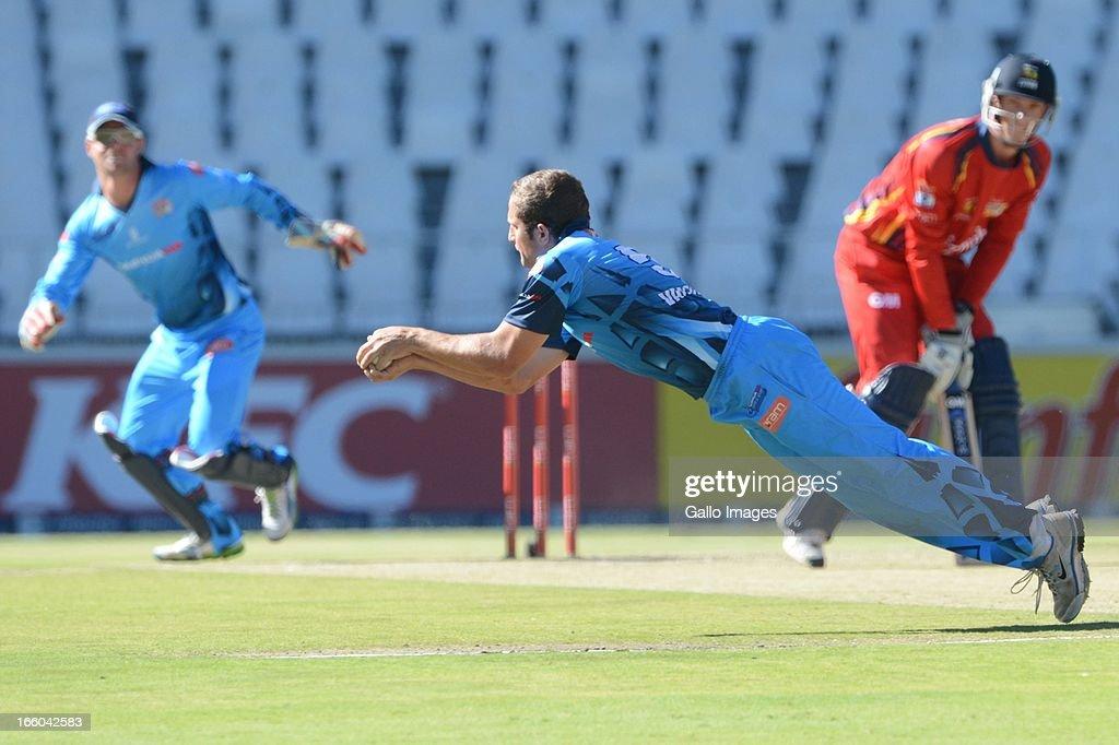 Roelof van der Merwe of the Nashua Titans takes the wicket of Rassie van der Dussen during the 2013 RAM Slam T20 Challenge Final between Bizhub Highveld Lions and Nashua Titans at Bidvets Wanderers Stadium on April 07, 2013 in Johannesburg, South Africa.