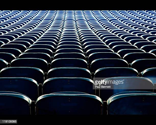 Roes of empty seats in football stadium