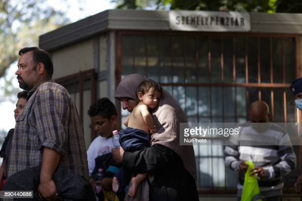 Roeszke Hungary Family waiting at train station Hungary has been a major transit country for migrants many of whom aim to continue on to Austria and...
