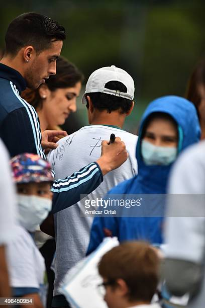 Rogelio Funes Mori of Argentina signs the shirt of a fan during a training session at Argentine Football Association 'Julio Humberto Grondona'...
