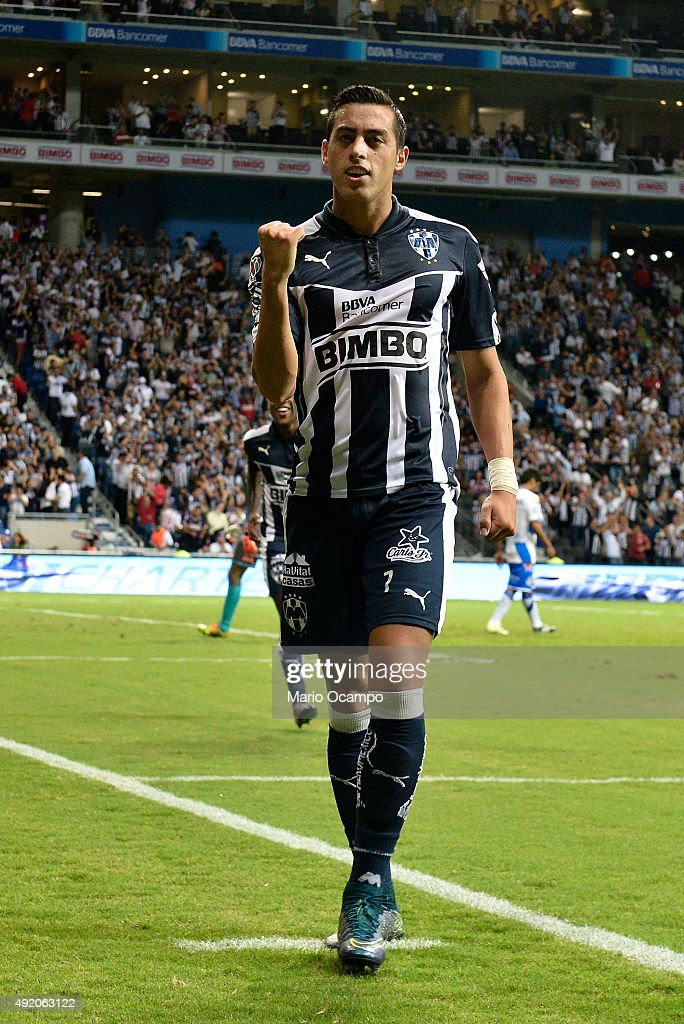 <a gi-track='captionPersonalityLinkClicked' href=/galleries/search?phrase=Rogelio+Funes+Mori&family=editorial&specificpeople=6717732 ng-click='$event.stopPropagation()'>Rogelio Funes Mori</a> of Monterrey celebrates after scoring his team's first goal during the 2nd round match between Monterrey and Puebla as part of the Apertura 2015 Liga MX at BBVA Bancomer Stadium on October 09, 2015 in Monterrey, Mexico.