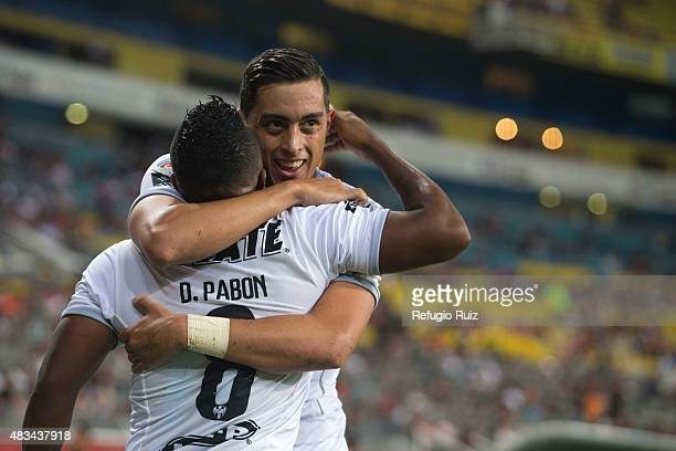 Rogelio Funes Mori of Monterrey celebrates with his teammates after scoring the first goal of his team during a 3rd round match between Atlas and...