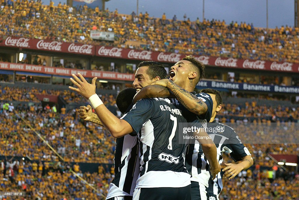 <a gi-track='captionPersonalityLinkClicked' href=/galleries/search?phrase=Rogelio+Funes+Mori&family=editorial&specificpeople=6717732 ng-click='$event.stopPropagation()'>Rogelio Funes Mori</a> of Monterrey celebrates with teammates after scoring his team's first goal during a 9th round match between Tigres UANL and Monterrey as part of the Apertura 2015 Liga MX at Universitario Stadium on September 19, 2015 in Monterrey, Mexico.