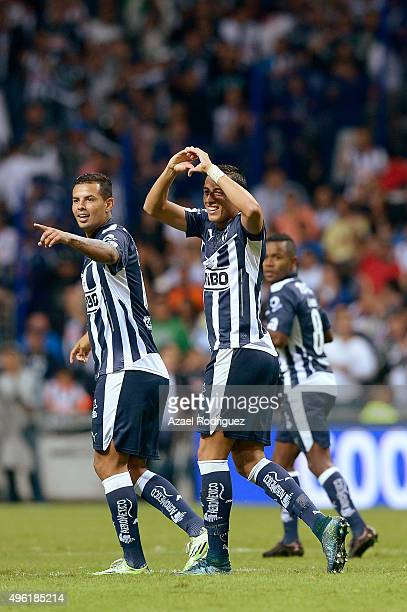 Rogelio Funes Mori of Monterrey celebrates with teammates after scoring his team's firts goal during the 16th round match between Monterrey and...