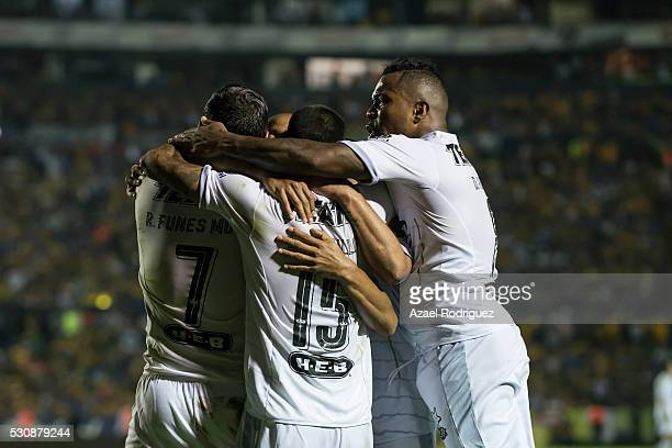 Rogelio Funes Mori of Monterrey celebrates with teammates after scoring his team's third goal during the quarter finals first leg match between...