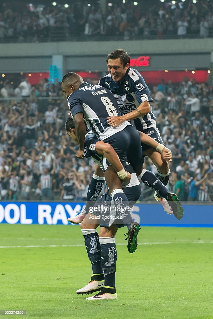 <a gi-track='captionPersonalityLinkClicked' href=/galleries/search?phrase=Rogelio+Funes+Mori&family=editorial&specificpeople=6717732 ng-click='$event.stopPropagation()'>Rogelio Funes Mori</a> of Monterrey celebrates with teammates after scoring his team's second goal during the semi finals second leg match between Monterrey and America as part of the Clausura 2016 Liga MX at BBVA Stadium on May 21, 2016 in Monterrey, Mexico.
