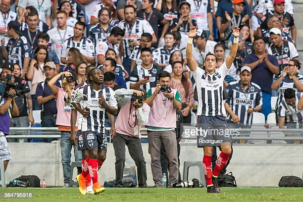Rogelio Funes Mori of Monterrey celebrates with teammates after scoring his team's first goal during the 3rd round match between Monterrey and Cruz...