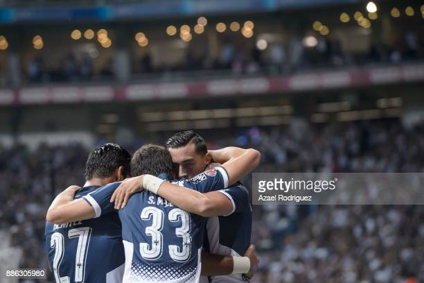 Rogelio Funes Mori of Monterrey celebrates with teammates after scoring his team´s first goal during the semifinal second leg match between Monterrey...